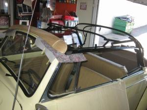 preparing to install a convertible top on this Volkswagen bug